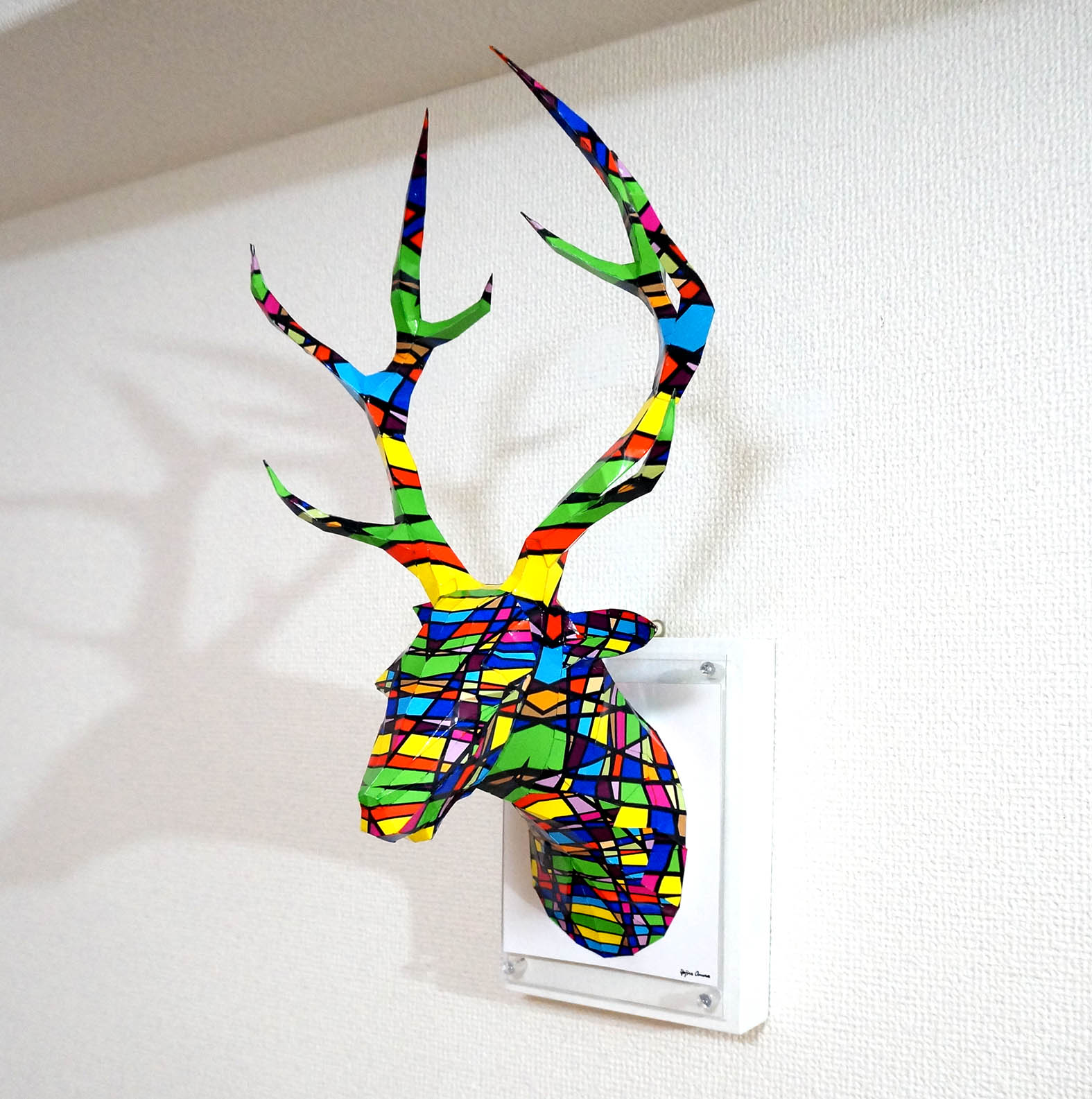 「Deer of the colorful grid」